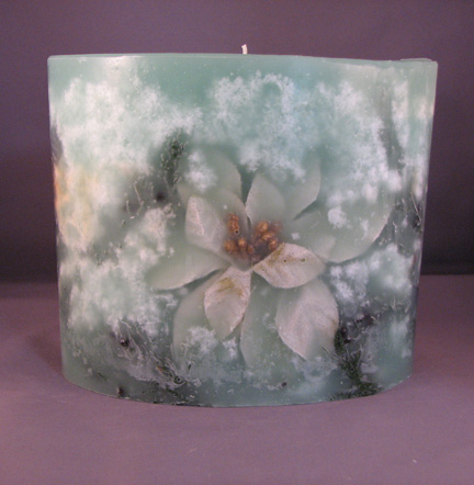 Large Oval Poinsettia and Juniper Embedded Candle
